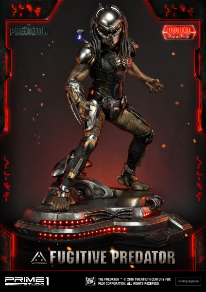 """Zum Action-Horror-Film """"Predator - Upgrade"""" kommt diese fantastische Statue vom Fugitive Predator. Das im Maßstab 1/4 gehaltene Sammlerstück ist ca. 75 x 58 x 49 cm groß und wurde aus hochwertigem Polystone gefertigt. Die Statue wird mit 2 austauschbaren"""